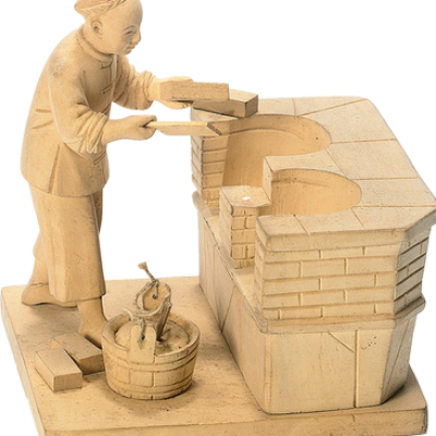 A mason building a brick stove